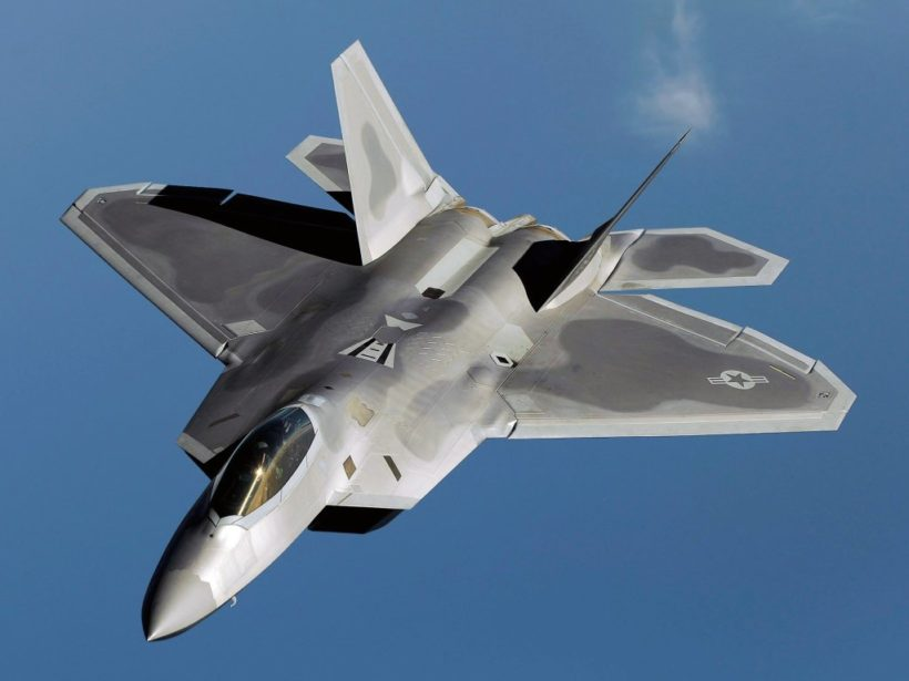 An F-22 Raptor flies over Kadena Air Base, Japan, Jan. 23 on a routine training mission.  The F-22 is deployed from the 27th Fighter Squadron at Langley Air Force Base, Va. (U.S. Air Force photo/Master Sgt. Andy Dunaway)