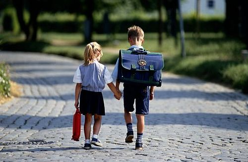 BOY AND GIRL ON WAY TO SCHOOL