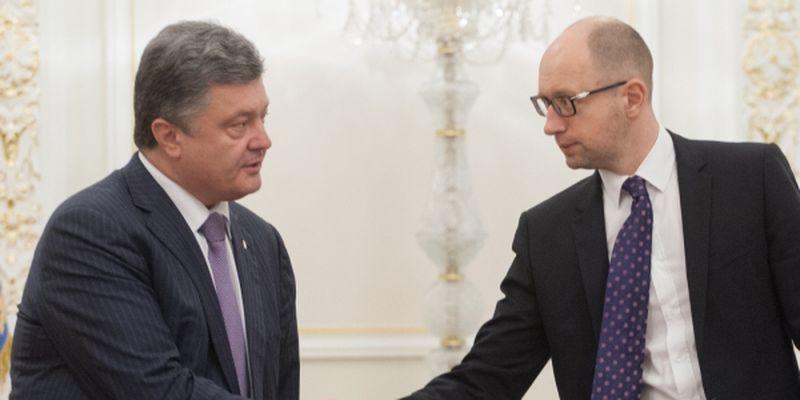 President of Ukraine Petro Poroshenko (to the left) and Prime Minister of Ukraine Arsenii Yatseniuk (to the right)