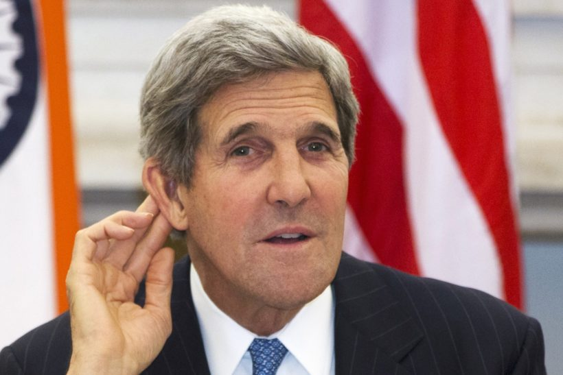 U.S. Secretary of State John Kerry gestures as he asks a reporter to repeat a question during a news conference with Indian Foreign Minister Salman Khurshid (not pictured) at Hyderabad House in New Delhi, India June 24, 2013. REUTERS/Jacquelyn Martin/Pool (INDIA - Tags: POLITICS)