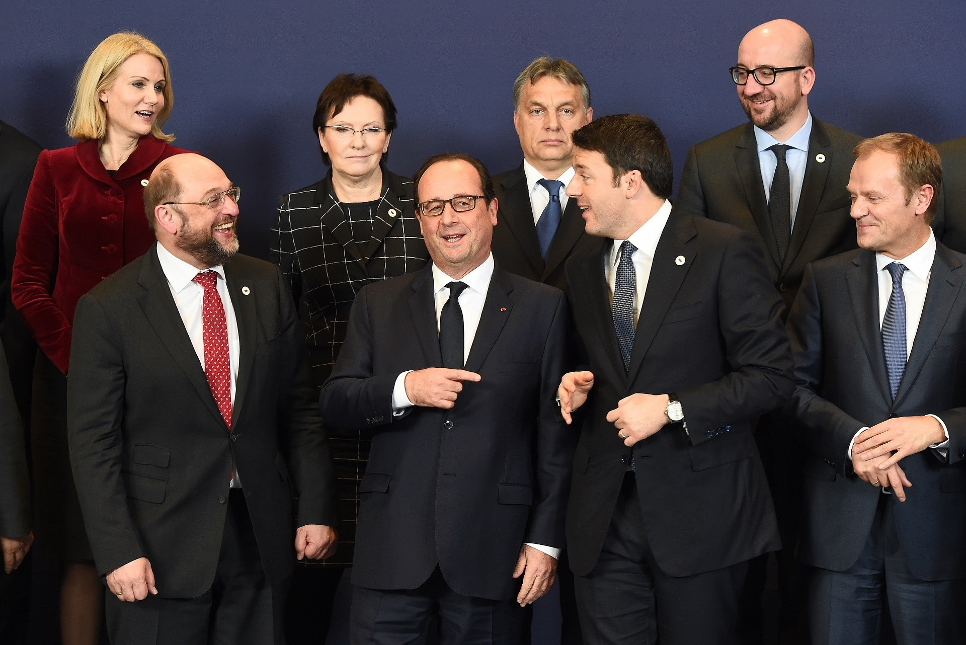 """(L-R) Danish Prime Minister  Helle Thorning-Schmidt, European Parliament President  Martin Schulz, Polish Prime Minister Ewa Kopacz, French President  Francois Hollande, Hungarian Prime Minister  Viktor Orban, Italian Prime Minister  Matteo Renzi, Belgian Prime Minister Charles Michel and European Council President Donald Tusk pose for a family photo during a European Council meeting in Brussels, December 18, 2014.   European Union leaders urged Vladimir Putin to make a """"radical change"""" in his stance on Ukraine Thursday as they boosted sanctions against Crimea despite fears of economic blowback from Russia's spiralling financial crisis.  AFP PHOTO/EMMANUEL DUNAND"""