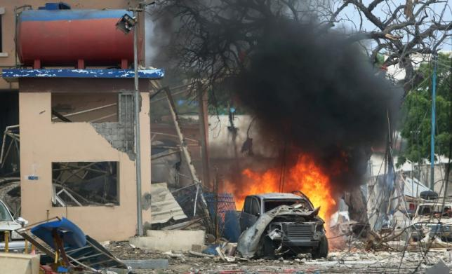 A vehicle burns at the scene of a suicide bomb attack outside Nasahablood hotel in Somalia's capital Mogadishu, June 25, 2016. REUTERS/Feisal Omar
