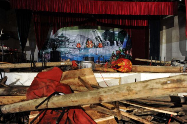 Chinese bride Shi Tsao, 27, could only watch in horror as she climbed onto the stage to address her wedding day guests seconds before the roof collapsed – burying over 100 of her friends and family. The tragedy believed to have happened because of heavy snow falls which caused the roof to give way left at least nine of the wedding guests dead, and more than 100 injured as rescue workers dug round the clock to remove the snow and rubble and Paul those buried underneath free. The tragedy happened in the early afternoon just as the hall which had been equipped with wedding decorations had opened to accept the guests in east China's Zhejiang Province. Of the 103 injured 12 were said to be in a critical condition according to coordinators of the rescue operation in Yazhuang village, in Panan County. The bride's new husband Yul Ch'eng been watching his pride on the stage with the other guests when the roof collapsed was among those hurt but not seriously. The couple and other family members were treated for shock after the tragedy which is still being investigated by local experts.